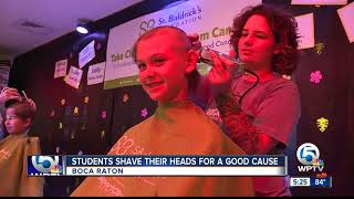 Students shave their heads for a good cause