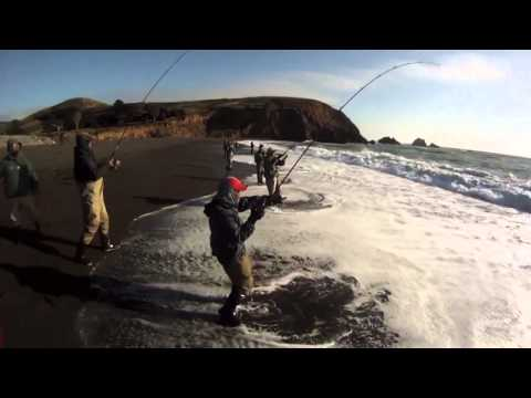EXTREME SALTWATER SURF FISHING for STRIPED BASS,,,using a DOBYNS ROD & my GoPro HD
