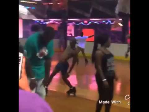 Half naked Nigerian on roller blades in a skating