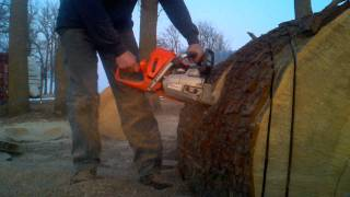 "Husqvarna 562xp chainsaw pulling a 36"" bar"