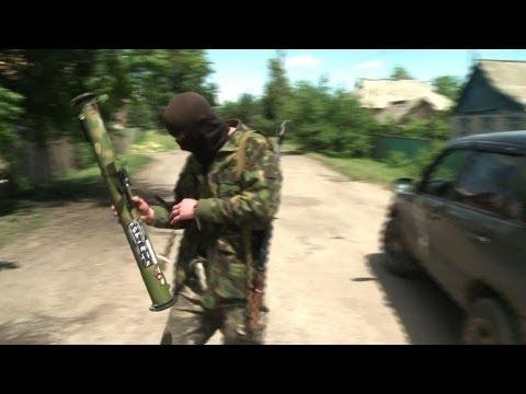 Fighting continues in eastern Ukraine despite cease-fire