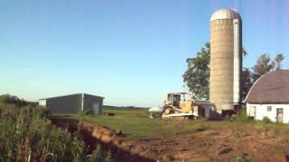 60 foot silo demolition with a d7 caterpillar