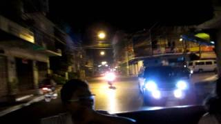 Hat Yai night street scene town centre from back of a pickup - 720P HD