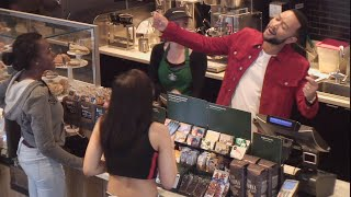 John Legend Serenades Customers and Hands Out Starbucks® Rewards!