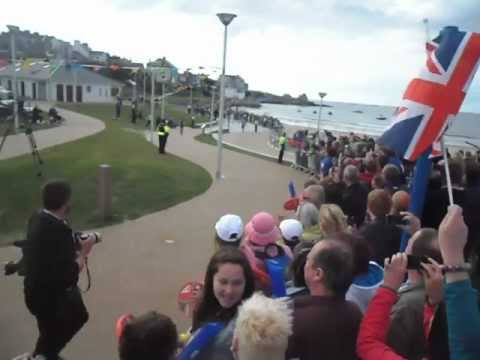 Local girl Louise Lyons carries the the Olympic Torch on the last leg of its relay in Portrush before lighting the Beacon on stage at the celebration concert.