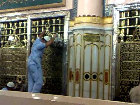 cleaning of Golden cover (Jaali ) of Roza-e Mubarak of Prophet...