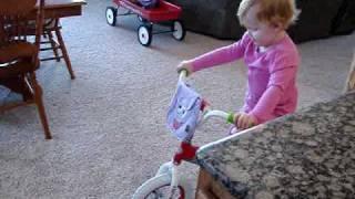 Kaitlyn riding new Dora bike.