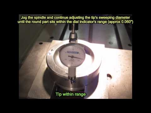 Dial-indicating a round part on a mill