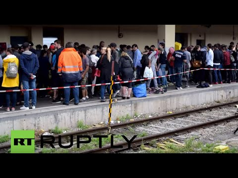 LIVE: Refugees arrive at Vienna's Westbahnhof following tough journey from Budapest