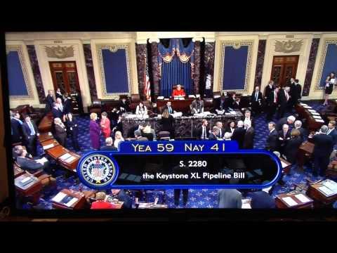 US Senate vote on Keystone Pipeline - Native American sings song in Senate gallery