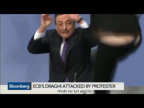 Mario Draghi Showered With Shouts, Confetti in Protest