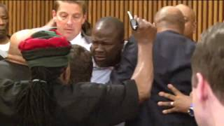 Victim`s family members jump on black serial killer Michael Madison