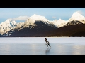 foto Ice Skating on a Frozen Alpine Lake