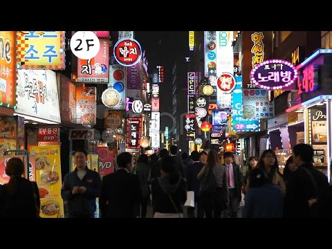 Seoul Night Neon Busy Crowd Shopping Street Electronic Asian Shopper South Korea. Stock Footage