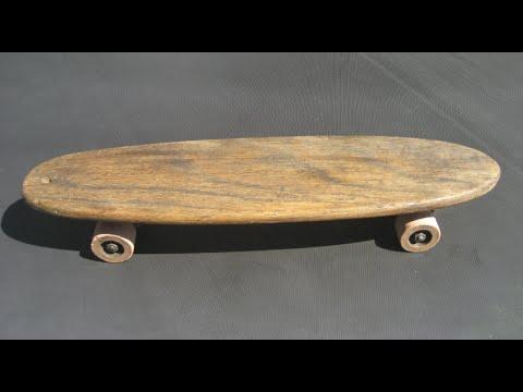 Riding A Vintage Skateboard.