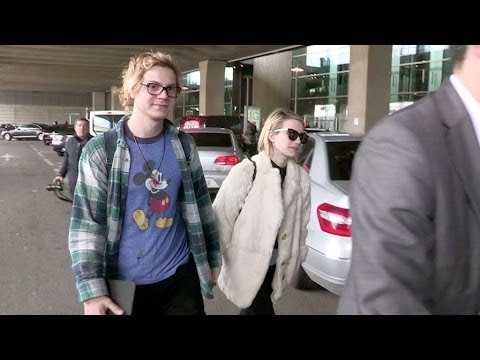 Fiances Emma Roberts And Evan Peters Show PDA At Paris Airport