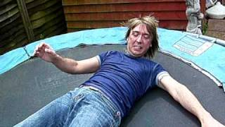 Mark Woodford charges himself with static electricity on a trampoline