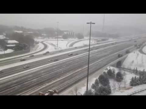 Snowplows Clearing Highway 401 in Toronto