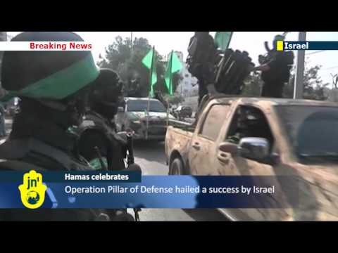 Hamas show of strength: Gaza militants mark anniversary of battle against Israel with mass parade