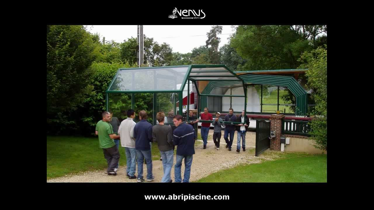 Installation d 39 un abri de piscine abris venus for Abris de piscine venus international