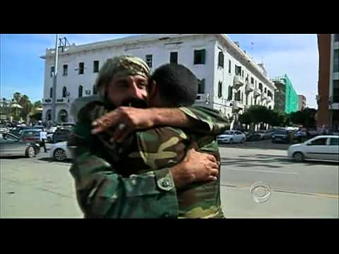 The CBS Evening News with Scott Pelley - Jubilation sweeps across Tripoli
