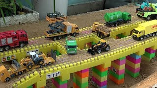 Cars Toys Bridge Construction on the Sand with Dump Truck, Loader, Bulldozer Video for Children