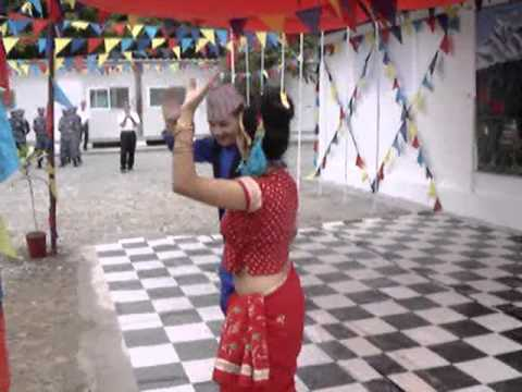 Nepali lady police officer dancing with police officer in haiti