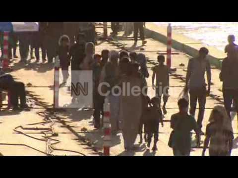 IRAQ: YAZIDI REFUGEES CROSS RIVER INTO SYRIA