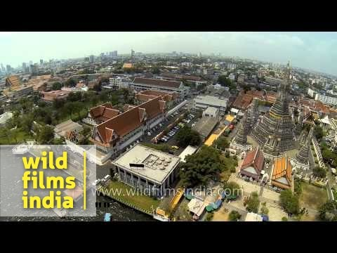 Aerial view of Wat Arun Temple along Chao Phraya River in Bangkok