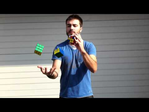 David Calvo juggles and solves Rubik's Cubes