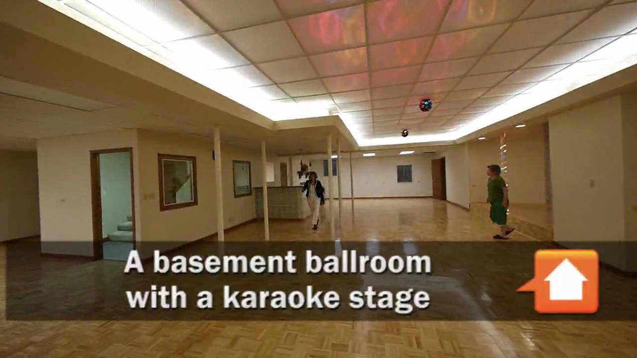a basement ballroom and karaoke stage in a riverwoods home