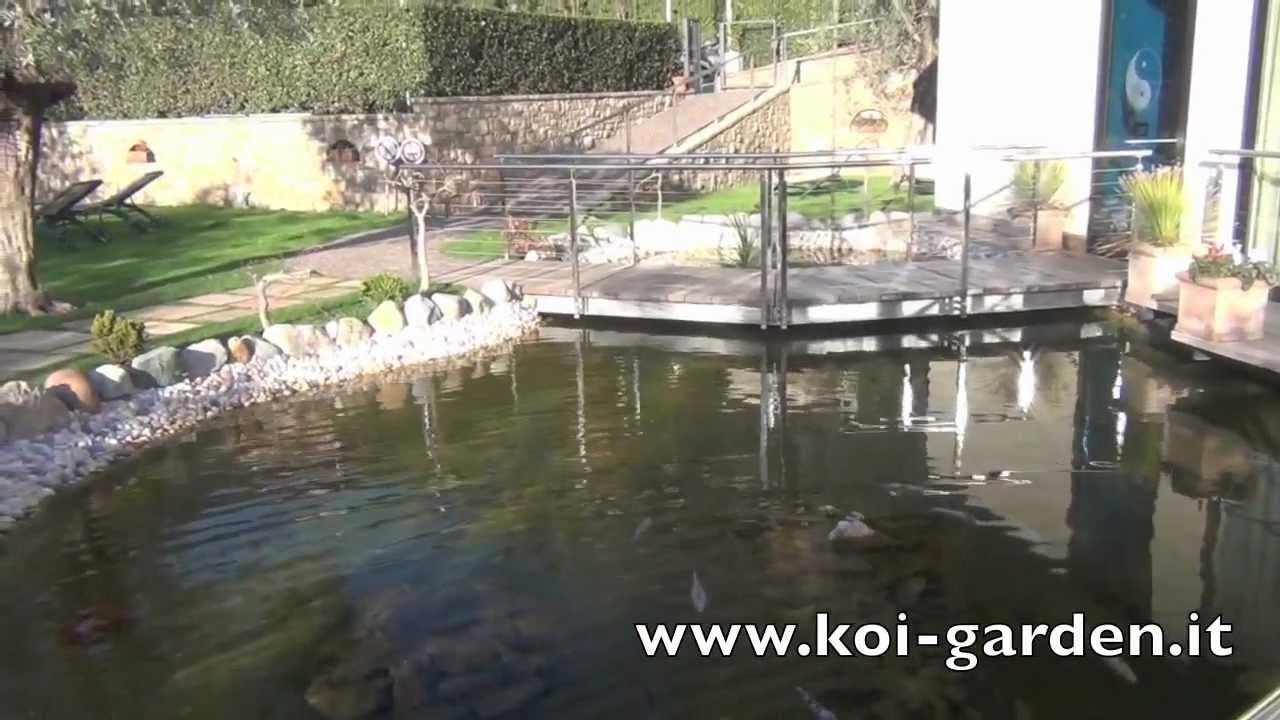 Laghetto con cascata e giochi d acqua made by koi garden for Costruzione laghetto koi