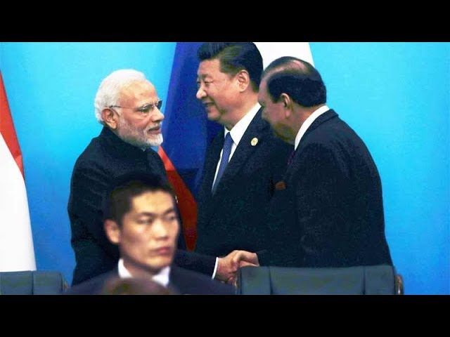 PM Modi, Pakistan President Mamnoon Hussain shake hands at SCO Summit in China's Qingdao