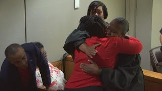 Judge Tammy Kemp embraces Botham Jean's family after trial