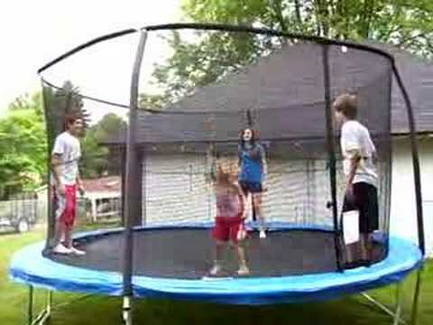 little girl gets bounced over trampoline net