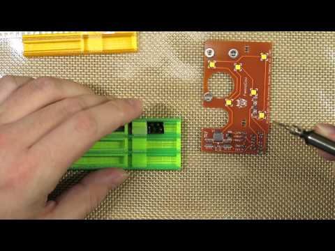 Manual SMD soldering using a vacuum pen and FemtoCow SMD trays