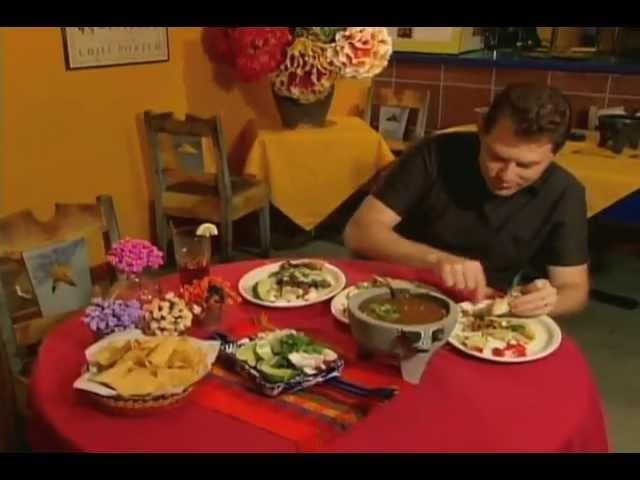Bobby Flay enjoys some Mole tacos (Carne Asada, Carnitas & Taco Taco)