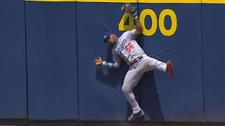 Puig leaps at the wall, makes fine catch