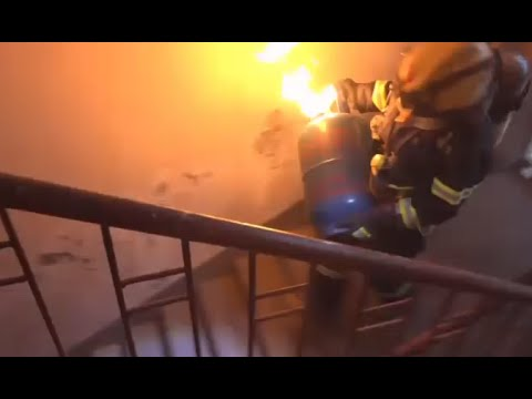No Fear! Fireman pulls burning gas tank from building in China