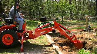 Installing a small water garden pond...With the Kubota B2920...