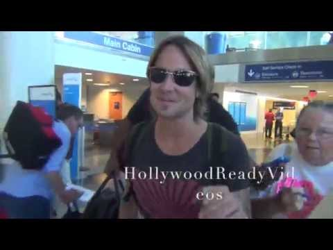 Keith Urban tries to swerve on paparazzi arriving in LA from NYC at LAX airport