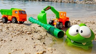 A Kids' Excavator and a Toy Truck. A Pool for Om Nom.
