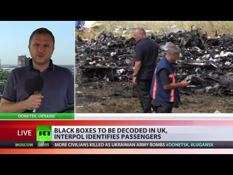 UK to decode MH17 black boxes, Interpol identifies bodies