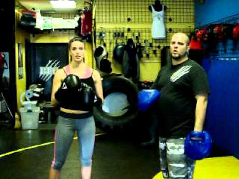Cardio Kick Boxing focus mitt work out.  Basic step to begin cardio boxing. Image 1