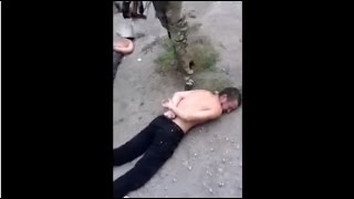 Kiev Fighters Execute Handcuffed Prisoner with Pot: Accidentally Caught on Video