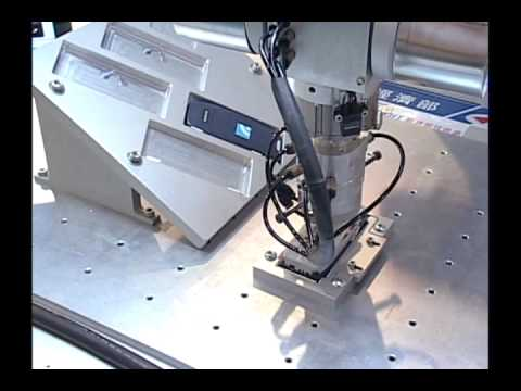 Cell phone assembly using a robot