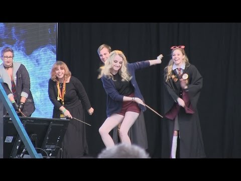 Harry Potter star Evanna Lynch duels in wand battle with guests at Universal Celebration