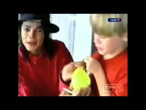 Michael Jackson Macaulay Culkin Throwing Water Balloons At Fans Below