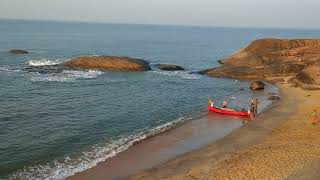 Early morning scene on someshwar beach as fishing boats return to sell their catch