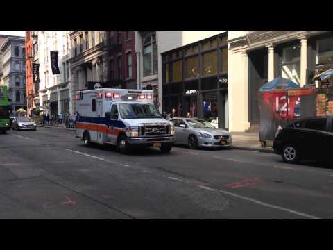 NEW YORK PRESBYTERIAN HOSPITAL EMS AMBULANCE RESPONDING ON BROADWAY IN SOHO, MANHATTAN, NEW YORK.